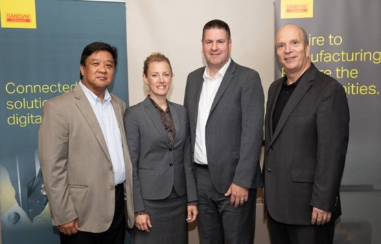 Sandvik Coromant's Jim Cordoviz, Annika Langéen and David Andrews with NAIT President & CEO Dr. Glenn Feltham